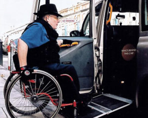 Wheelchair user getting into a Dublin Black Cab.
